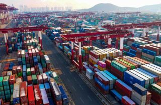 Containers are seen stacked at a port in Qingdao, China, on Jan. 14, 2020.