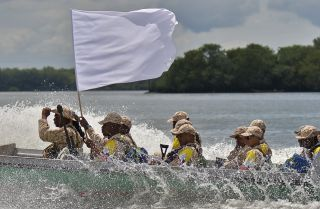FARC insurgents, flying a white flag of truce, head toward the Pacific coast city of Buenaventura, Colombia, to surrender their weapons to U.N. monitors. In agreeing to lay down its arms, the rebel group lost the power it once had to threaten the government. Some FARC factions have continued to pursue criminal interests.