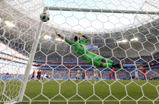 Keylor Navas, a goalkeeper for Costa Rica's national soccer team, tries to block a shot in a match against Serbia during the 2018 World Cup.