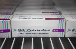 Boxes of vials of the AstraZeneca COVID-19 vaccine sit in a refrigerator at Ashton Gate Stadium in the English city of Bristol on Jan. 9, 2021.
