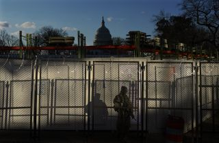 A National Guardsman monitors a security checkpoint near the U.S. Capitol on Jan. 20, 2021, in Washington.