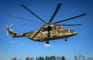 A Russian military helicopter Mi-26T2V flies during an exhibition flight at the Mil Moscow Helicopter plant outside Moscow on April 3, 2019.