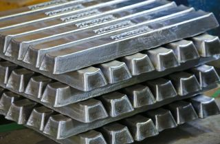 This photograph shows bars of aluminum.