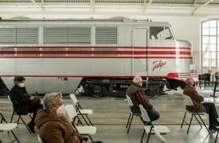 People wait in an observation area at a COVID-19 vaccination site in the Catalonia Railway Museum on April 15, 2021, in Vilanova i la Geltru, Spain.
