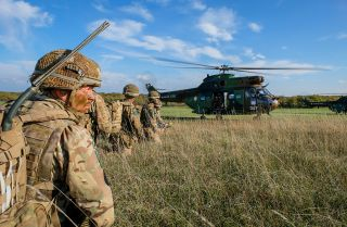This photo shows French, British and U.S. paratroopers training together in south of France.
