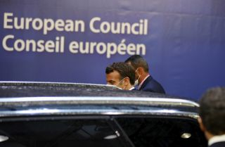 French President Emmanuel Macron leaves the European Council building in Brussels, Belgium, on July 20, 2020. Leaders from the 27 EU member states met on July 19 to discuss the bloc's budget and new COVID-19 recovery package.