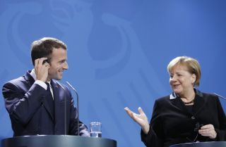 German Chancellor Angela Merkel (R) and French President Emmanuel Macron address the media during a press conference in the German chancellery on Nov. 18, 2018, in Berlin.