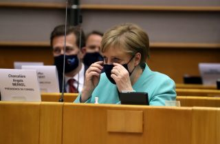 German Chancellor Angela Merkel wears a protective face mask as she attends a plenary session at the European Parliament in Brussels, Belgium, on July 8, 2020.