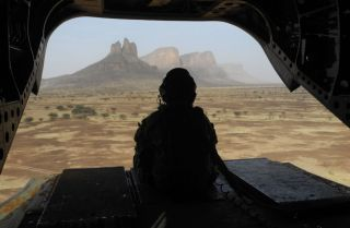 A British soldier leaves the Hombori area aboard a Chinook helicopter on March 28, 2019, during the start of the French Barkhane Force operation in Mali's Gourma region.