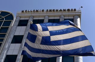 The Greek flag flies just outside the country's stock exchange.