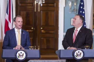 British Foreign Secretary Dominic Raab speaks with U.S. Secretary of State Mike Pompeo.