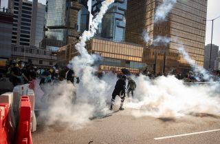 Protesters fleeing tear gas during a general strike in Hong Kong in August 2019.