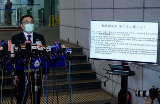 Hong Kong Police Force Senior Superintendent Steve Li Kwai-Wah holds a press briefing following the arrest of dozens of opposition figures under the city's national security law on Jan. 6, 2021.