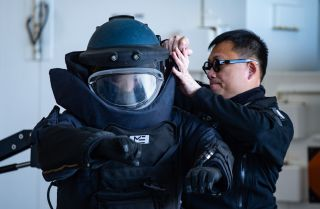 A police officer wears a bomb suit during a Dec. 6 event hosted by the Hong Kong Police Department's Explosive Ordnance Disposal Bureau (EOD).
