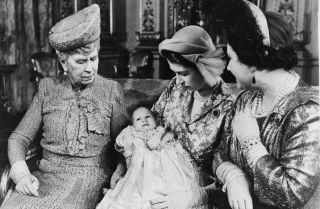 Princess Elizabeth (later Queen Elizabeth II) holds her daughter, Princess Anne, at Anne's christening in Buckingham Palace on Oct. 21, 1950. Elizabeth's grandmother, Queen Mary, left, and her mother, Queen Elizabeth are also pictured.