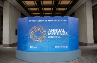 A promotional board for the annual series of meetings between the International Monetary Fund (IMF) and the World Bank is seen outside the IMF headquarters in Washington D.C. on Oct. 13, 2020.