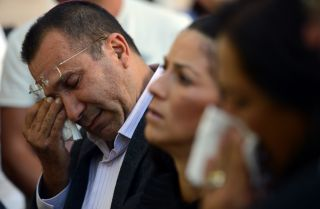 Relatives of the five Israeli victims of a suicide blast that targeted a bus of tourists in Bulgaria mourn in Sofia on Aug. 28, 2012.