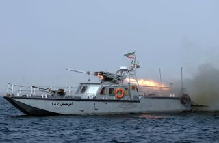 "An Iranian war-boat fires a missile during the ""Velayat-90"" navy exercises in the Strait of Hormuz in southern Iran."