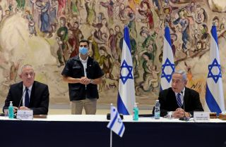 Israeli Prime Minister Benjamin Netanyahu (right) and Alternate Prime Minister and Defence Minister Benny Gantz (left) attend a cabinet meeting in the Knesset on May 24, 2020.