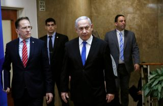 Israeli Prime Minister Benjamin Netanyahu (C) arrives at a weekly Cabinet meeting in Jerusalem on Dec. 8, 2019.