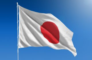 The Japanese flag, a red dot on a white background, celebrates the country's nickname: The Land of the Rising Sun.