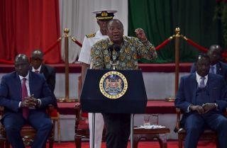 Kenyan Deputy President William Ruto (left) and opposition leader Raila Odinga (right) listen to President Uhuru Kenyatta (center) give a speech in Nairobi, Kenya, on Nov. 27, 2019.