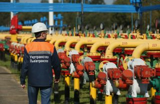 A worker walks among pipes and valves at the Dashava natural gas facility on September 18, 2014 in Dashava, Ukraine.