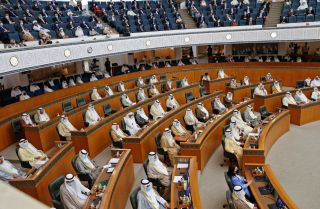 Kuwaiti legislators attend a parliamentary session at the National Assembly building in Kuwait City, Kuwait, on Oct. 20, 2020.