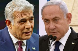 A photo combination shows the leader of Israel's centrist Yesh Atid party, Yair Lapid (left), next to Israeli Prime Minister Benjamin Netanyahu of the Likud party.