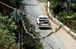 An illegal connection to the public electricity grid in Caracas on March 4