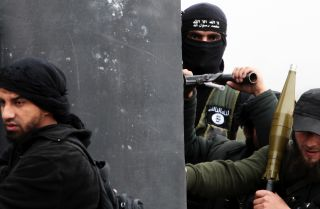 In 2013, Jabhat al-Nusra was firmly aligned with al Qaeda, whose flag adorns the jacket of one of its fighters in Syria. But the group has changed its name, a tactic the organization has adopted to give its units more flexibility.
