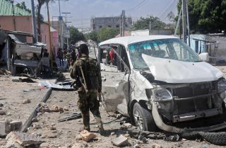 The aftermath of a car bomb that detonated near the Peace Hotel in Mogadishu, Jan. 2. Al Qaeda has survived against the odds, and in places such as Somalia could surge back to power if African Union troops withdraw.