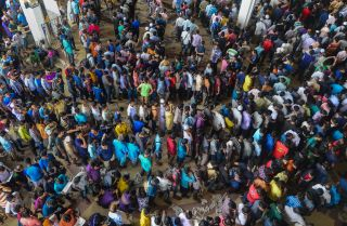 Bangladeshi travelers collect tickets at a railway station in Dhaka ahead of the Eid al-Fitr holiday, running from June 25-28, which marks the end of Ramadan.