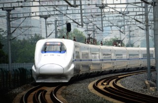 A high-speed train travels on the railway to Beijing in Nanning, southern China's Guangxi province on June 13, 2014.