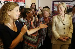 U.S. Rep. Debbie Wasserman Schultz (L) introduces Democratic presidential nominee Hillary Clinton in August. Many have accused Russia of trying to damage Clinton's campaign to give her opponent, Donald Trump, a leg up.