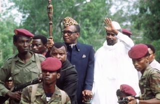 Hissene Habre (R), then-president of Chad, greets Mobutu Sese Seko (L), then-president of Zaire, on his arrival in Ndjamena on Aug. 20, 1983. For African leaders in charge of poor, weak states, maintaining personal security is a perennial challenge.