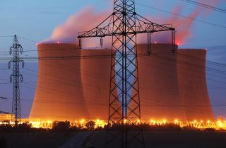 Streetlights illuminate the four cooling towers of the Temelin nuclear power plant in the Czech Republic in 2011.