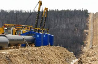 View of pipes and equipment near a trench of the Eastern Siberia-Pacific Ocean oil pipeline in Siberia, Russia.