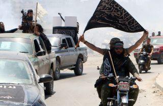 Fighters from Al-Qaeda's Syrian affiliate, Jabhat al-Nusra