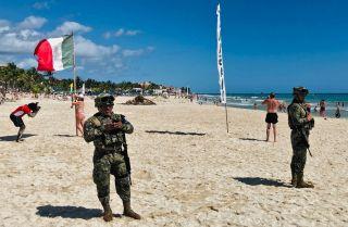 Mexican marines patrol the beach of Playacar, near the seaside tourist resort of Playa del Carmen, Quintana Roo State, on Feb. 14, 2019.