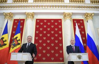 Moldovan President Igor Dodon (left) speaks during a joint conference with his Russian counterpart, Vladimir Putin, at the Kremlin in Moscow on Jan. 17, 2017.