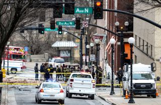 FBI and first responders work on the scene after an explosion in Nashville, Tennessee, on Dec. 25, 2020. According to initial reports, a vehicle exploded downtown in the early morning hours of Christmas Day.
