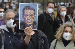 A demonstrator displays a portrait of Russian opposition leader Alexei Navalny during a protest in Berlin, Germany, on April 21, 2021.