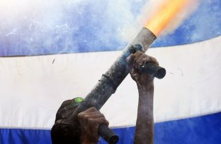 A protester with the April 19th movement in Masaya, Nicaragua, fires a homemade mortar into the air on June 18, 2018.