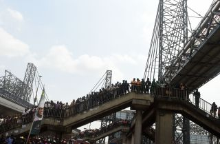 People attend the inauguration of the Oshodi Transport Interchange, a multistory bus terminal in Lagos, Nigeria, on April 24, 2019.