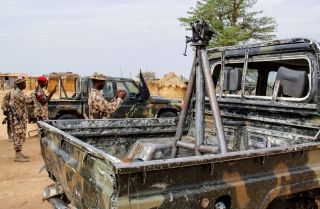 Soldiers take snapshots of vehicles allegedly belonging to ISWAP in Baga, Nigeria, on Aug. 2, 2019.
