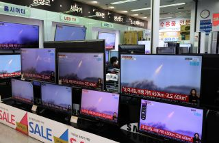 TV screens show the launch of North Korean missiles on March 25, 2021, in Seoul, South Korea.