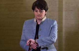 Northern Ireland's first minister and leader of the Democratic Unionist Party (DUP), Arlene Foster, looks at her watch outside the Parliament Buildings in Belfast.