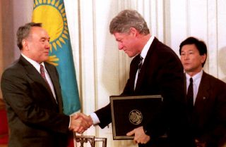 U.S. President Bill Clinton and Kazakh President Nursultan Nazarbayev shake hands at the White House on Feb. 14, 1994, after Nazarbayev presented Clinton with Kazakhstan's accession to the Nuclear Nonproliferation Treaty.