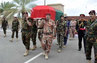Omani army officers carry Sultan Qaboos bin Said al Said during a funeral procession Jan. 11 in Muscat.